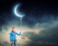 Woman with moon Stock Photo