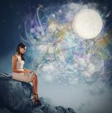 Woman and the moonlight Royalty Free Stock Image