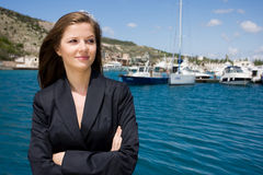Woman and moorage with boats Stock Photos