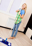 Woman with mop Stock Images