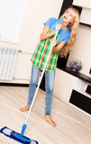 Woman with mop Royalty Free Stock Photos