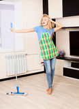 Woman with mop Stock Photo