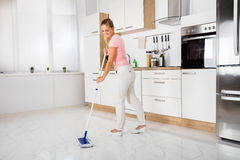 Woman With Mop Standing In The Kitchen. Smiling Cleaning Service Woman With Mop Cleaning Floor In The Kitchen At Home stock image