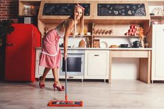 Woman Is Moping The Floor royalty free stock images