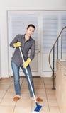 Woman Mopping  Floor Stock Photos