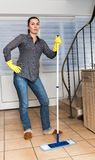 Woman Mopping  Floor Stock Image