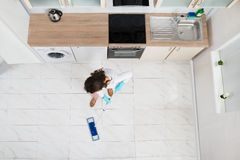 Woman Mopping Floor Stock Photography
