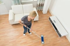 Woman Mopping Floor Royalty Free Stock Images