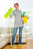 Woman mopping floor and singing. Funny woman mopping floor and singing Stock Image