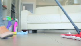 Woman mopping the floor stock video footage