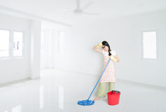 Woman mopping house. Young Asian woman mopping floor with water, cleaning house Royalty Free Stock Photos