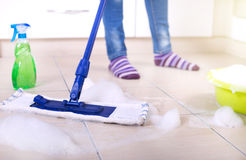 Woman mopping kitchen floor Royalty Free Stock Photos