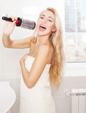Woman in the morning at bathroom. Funny female sing song in comb Stock Photos