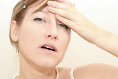 Woman morning headech. Pretty woman hat morning headache Stock Photography