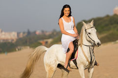 Woman morning horse ride. Gorgeous young woman enjoying morning horse ride on beach Royalty Free Stock Photography