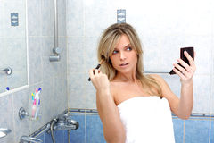 Woman during daily morning routines Royalty Free Stock Images
