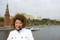 Woman and Moscow kremlin close up Royalty Free Stock Image