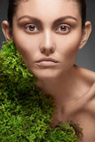 Woman with moss growing on her neck royalty free stock photography