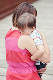 Woman mother comforting her crying little toddler boy son. Portrait of  young Caucasian women mother comforting her crying little toddler boy son outside in park Royalty Free Stock Images