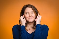 Woman, mother crossing her fingers Royalty Free Stock Photography