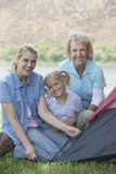 Woman With Mother And Daughter Putting Up A Tent Stock Photos