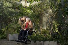 Woman with Mother in Garden - Horizontal Stock Photo