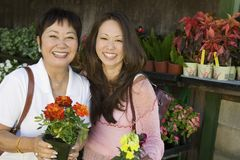 Woman with mother holding flowers Royalty Free Stock Photography