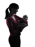 Woman mother hugging baby silhouette Royalty Free Stock Photos