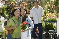 Woman with mother in plant nursery portrait Stock Image