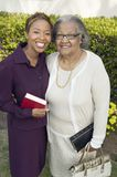 Woman and Mother standing in garden with Bibles portrait Royalty Free Stock Photography