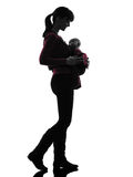 Woman mother walking baby silhouette royalty free stock images