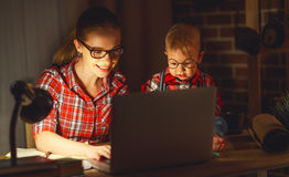 Woman Mother Working With A Baby At Home Behind A Computer Stock Photos