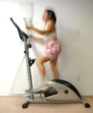 Woman in Motion on Elliptical Stock Photos
