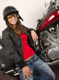 Woman beside Motorcycle sexy huge smile Stock Images
