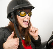 Woman beside Motorcycle thumbs up sign Royalty Free Stock Photos