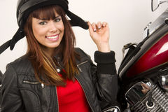 Woman beside Motocycle playing with helmet straps Stock Images