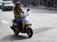 Woman On Motor Bike. Motorbiker in traffick Royalty Free Stock Photography