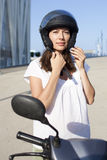 Woman with motor bike Stock Image