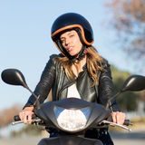 Woman on motor bike driving Royalty Free Stock Photo