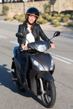 Woman on motor bike driving Royalty Free Stock Photos