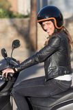Woman on motor bike driving Royalty Free Stock Images