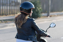 Woman on motor bike driving Stock Photography