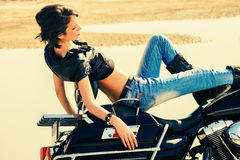 Woman on motorbike Stock Photos