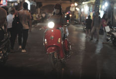 Woman on motorbike in Hanoi Vietnam Stock Photography