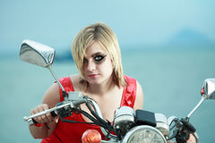 Woman with a motorcycle Royalty Free Stock Photos