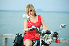 Woman with a motorcycle Royalty Free Stock Photo