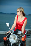 Woman with a motorcycle Royalty Free Stock Images