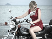 Woman with a motorcycle Royalty Free Stock Photography