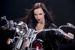 Woman on the motorcycle Royalty Free Stock Image