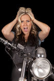 Woman motorcycle on black hands hair mad Stock Image
